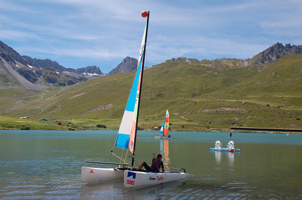 Sailing a catamaran in Tignes lake